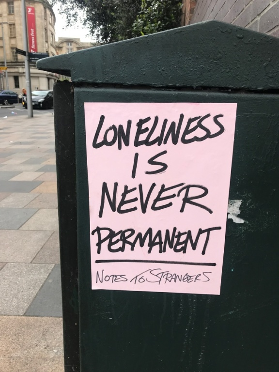 A poster saying 'loneliness is never permanent'